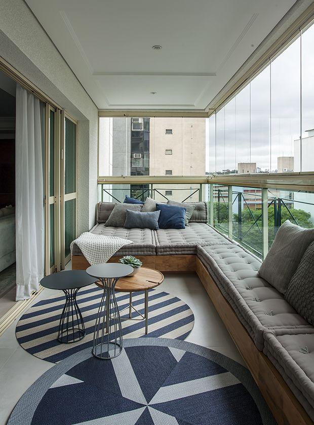Terraza con cortinas de cristal
